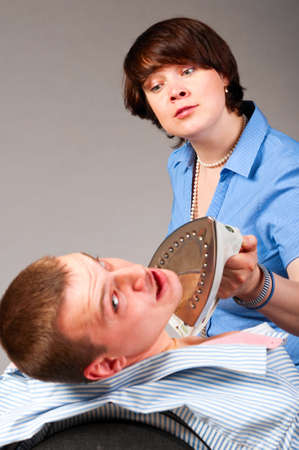 strict: iron violence Stock Photo
