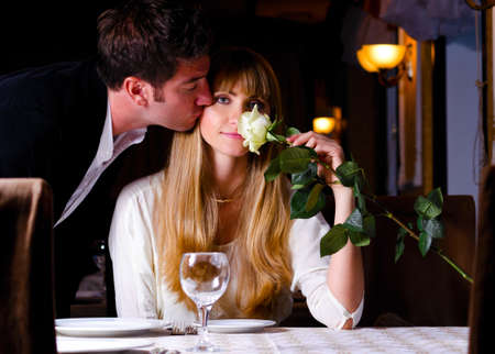 adult dating: couple at restaurant Stock Photo