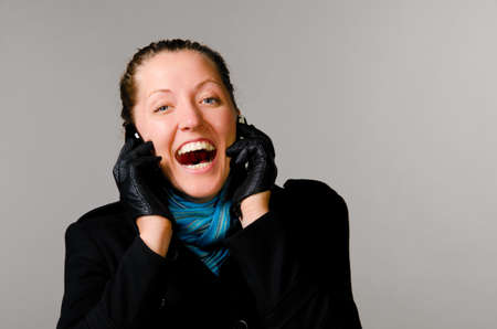 woman with two mobile phones photo