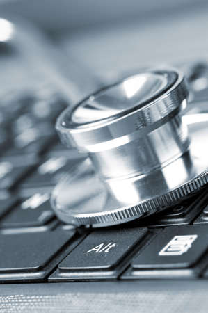 stethoscope on keyboard photo