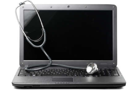 stethoscope on laptop photo