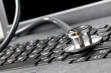 diagnostic tool: stethoscope on keyboard