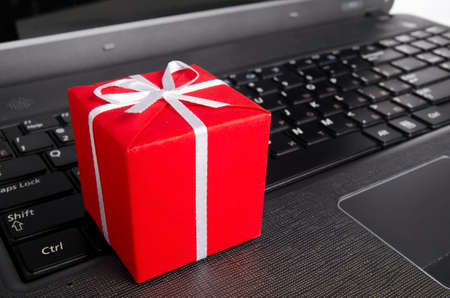 new office space: gift on a laptop keyboard