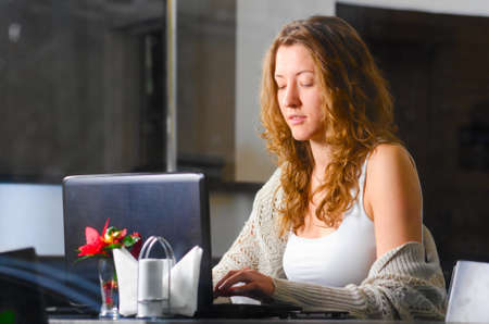 woman is working on laptop photo