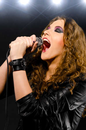 woman open mouth: singing rock song