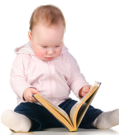 baby is reading a book photo