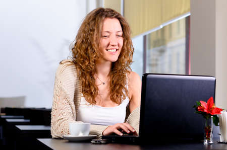 young woman is working on laptop photo