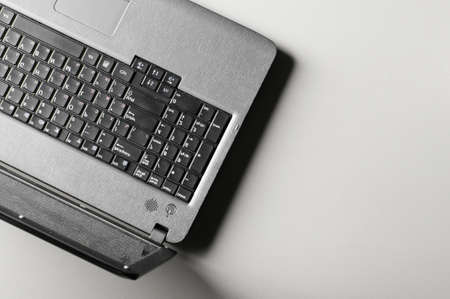 modern black laptop on grey table, view from above photo