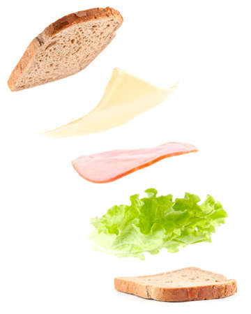 sandwich ingredients in air, isolated on white photo