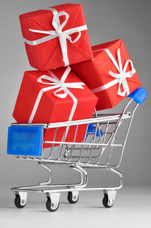 three gift boxes: closeup of a shopping cart with gifts