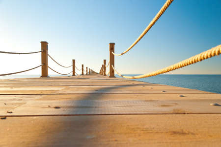 wooden dock: close up view of tropical wooden pier at sunny weather, clear skies