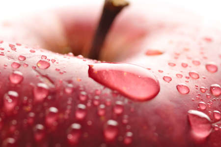 big apple: red wet apple with big droplet, macro shot Stock Photo