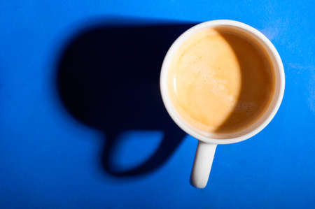 cup of fresh espresso coffee on table, view from above photo