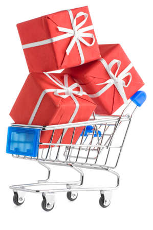 closeup of a shopping cart with gifts isolated on white photo