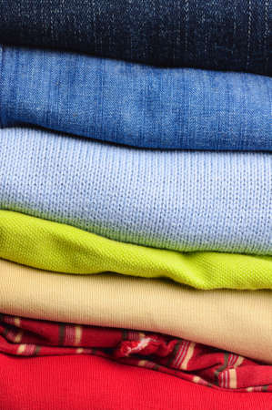 men s: stack of multicolored men s clothing Stock Photo
