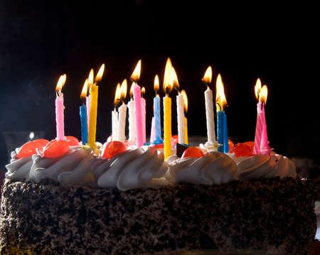 candles in dark: anniversary cake