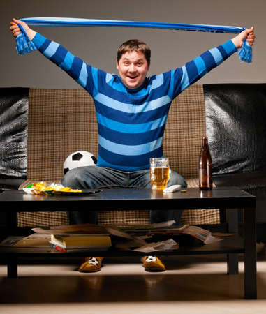 soccer fan on sofa Stock Photo - 13799663