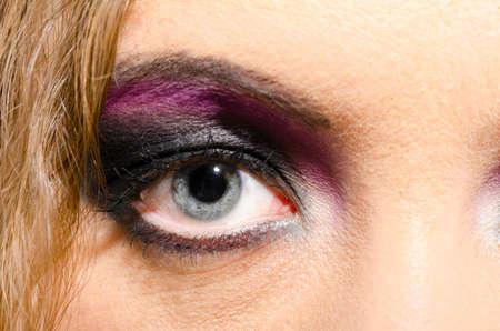 pink lips: female eye close-up Stock Photo