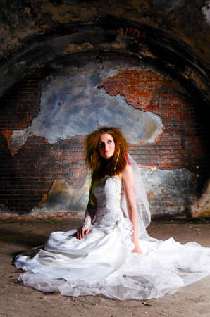 mud wall: trash the dress woman