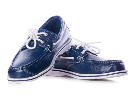 lace up: blue leather deck shoes Stock Photo