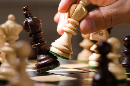 new strategy: wooden chess pieces Stock Photo