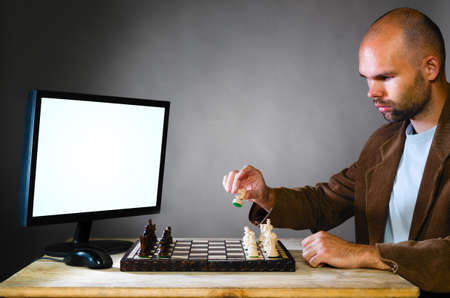 human chess player against computer photo
