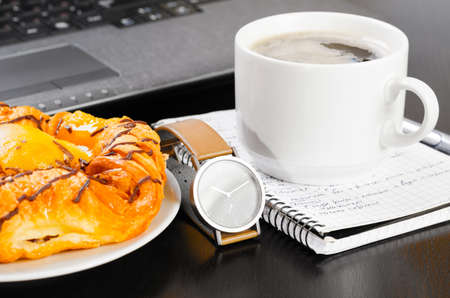 laptop and cup of coffee photo
