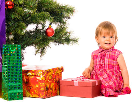 baby near christmas tree photo