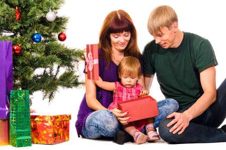 baby near christmas tree: baby near christmas tree Stock Photo