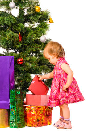 baby near christmas tree: baby near christmas tree Stock Photo