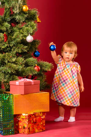 baby with christmas toy photo
