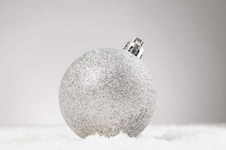 decorative ball on snow photo