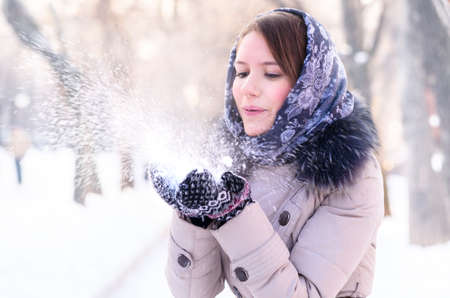 woman is blowing snow photo