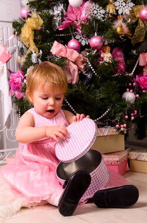 baby open present: opening a present
