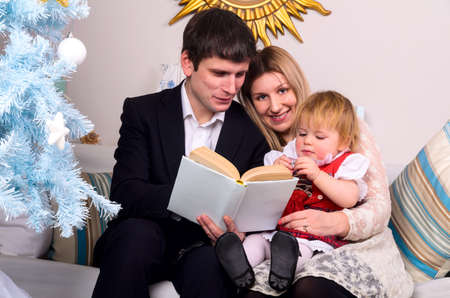 couple with baby are reading photo