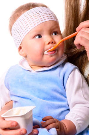 woman is feeding her baby Stock Photo - 17286968
