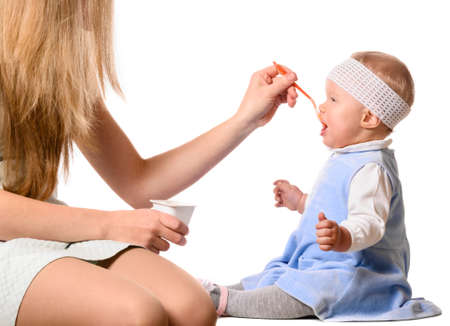 woman is feeding her baby photo