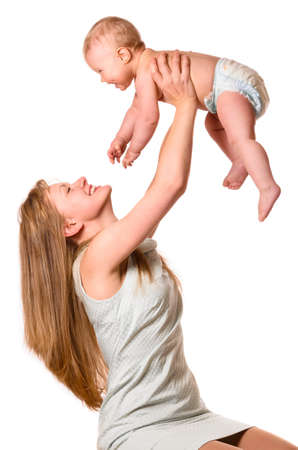 woman is holding her baby photo