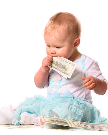 baby is eating money photo