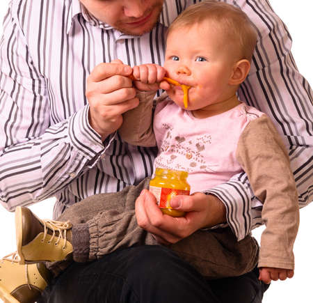 man is feeding his baby photo