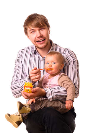 man is feeding his baby photo