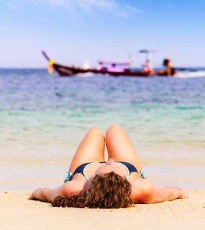 woman is lying on beach Stock Photo - 17801482