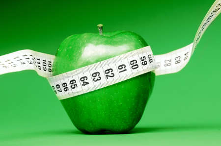 Delicious apple with measuring tape Stock Photo - 17910492