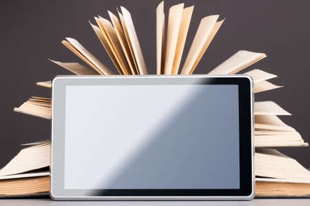 Books and tablet Stock Photo - 18023000