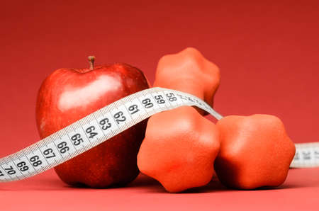 Delicious apple with measuring tape photo