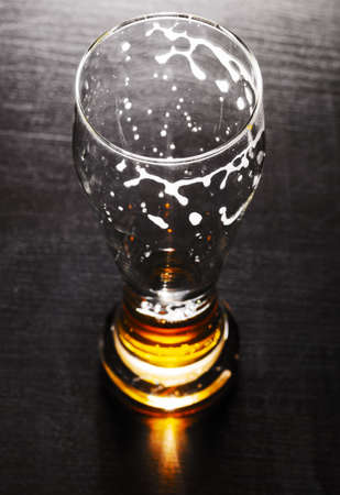 drained glass of lager beer on table Stock Photo