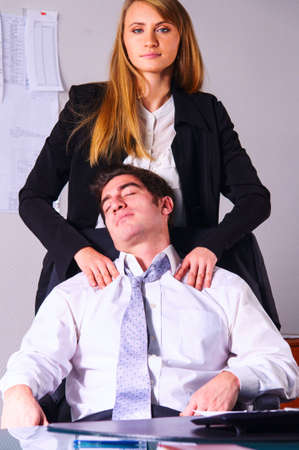 young businesswoman is making head massage to her teammate Stock Photo - 18706550