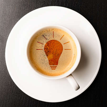 idea  cup of fresh espresso with bulb sign, view from above Stock Photo - 18705621