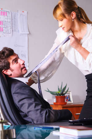 businesswoman is seducing her boss at office Stock Photo - 18706527