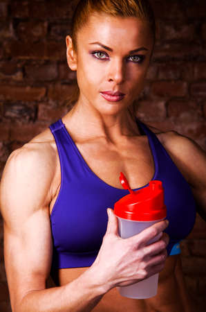 strong woman with sports nutrition photo